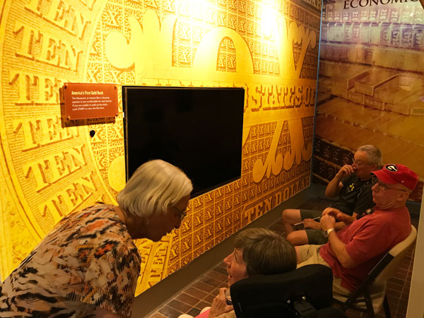 Golden exhibit featuring a television